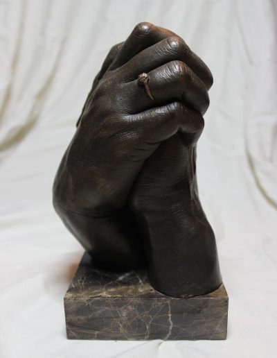 Hands in Hydrostone with Pigmented Resin on Marble base