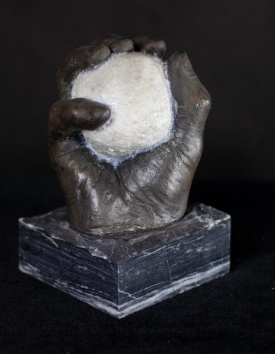 Hydrostone life cast with cold cast bronze and Alabaster dust on stone base