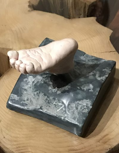 Baby foot that swivels on Stone Base. Hydrostone and Acrylics