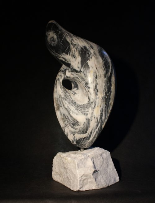 The Shore - Black and white stone with beautiful serpentine swirls that moves on a white marble base